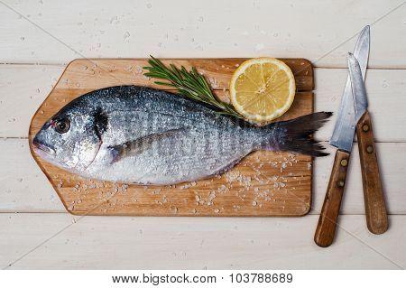 Salted Dorada, Rosmarine, Lemon, Board And Knifes