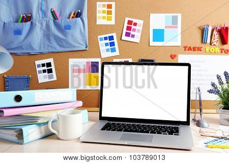 Workplace with laptop, close up