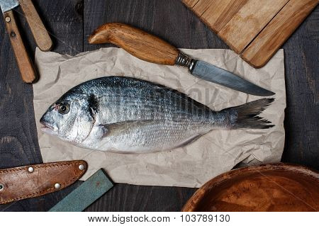 Raw Dorada On The Wooden Table