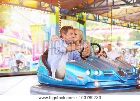 Senior couple at the fun fair