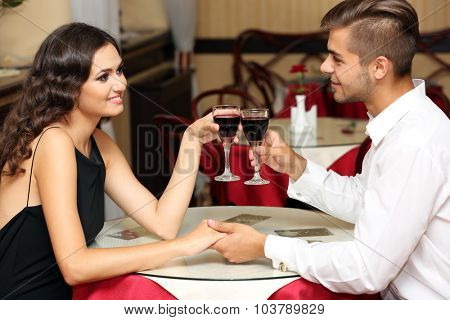 couple in love cheers at the restaurant