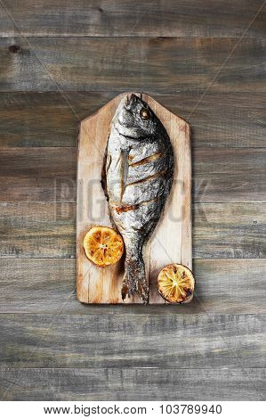 Prepared Fish On The Old Wooden Table
