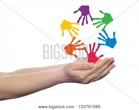 Concept or conceptual circle or spiral set made of colorful painted human hands in palm isolated on white background