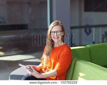 happy student girl working on tablet computer at modern school university indoors