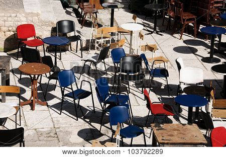 Chaotical Scene With Retro Chairs And Tables