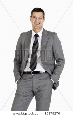 businessman with hands in pocket isolated on white background