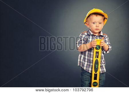 cute child act like handyman and gray grunge background