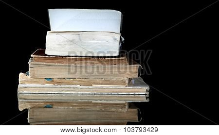 Stack Of Old Books With Vintage Pages Reflected