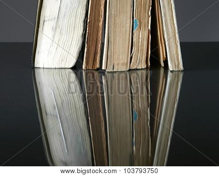 Pile Of Old Books With Vintage Pages Reflected