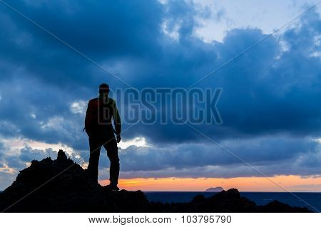 Hiking or trail running accomplish silhouette hiker backpacker man and success in inspirational suns