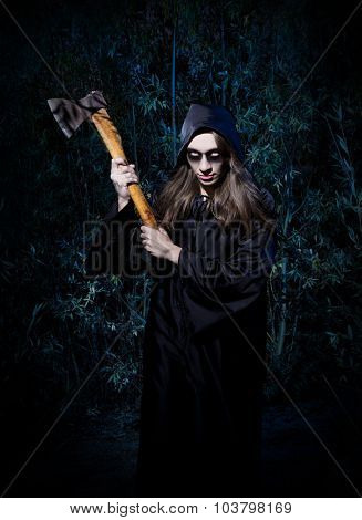 Woman with axe in forest