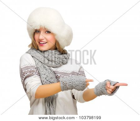 Young girl with fur hat showing pointing background isolated
