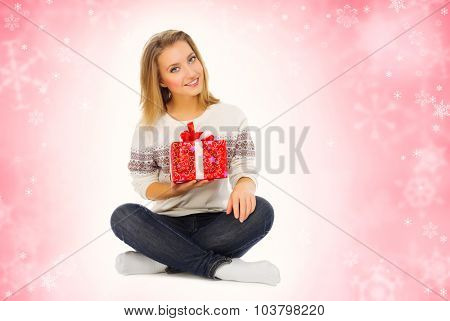 Young smiling girl with gift box isolated