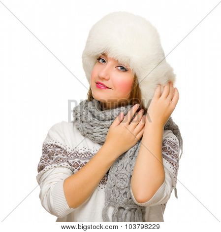 Young girl in fur hat isolated