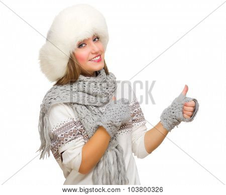 Young girl with fur hat showing ok gesture isolated