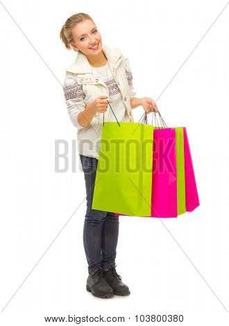 Young smiling girl with bags isolated