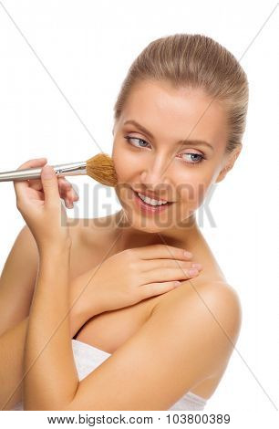 Young healthy girl with makeup brush isolated