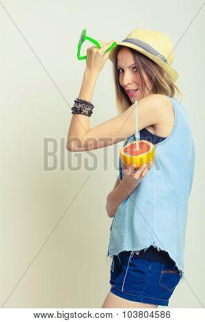 Summer Girl Holding Grapefruit Drink