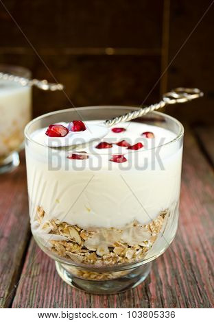 Healhty breakfast with oatmeal, yogurt and pomegranate berries