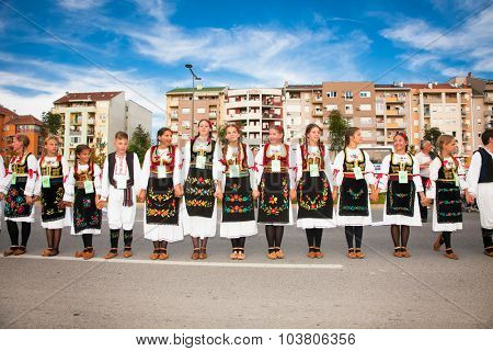 NOVI SAD, SERBIA-OCT 4, 2015: Guinness World Record Largest Folk Dance on Oct 4. 2015 in Novi Sad, Serbia. Over 12.000 participants to break the Guinness World Record by simultaneously dancing a Kolo
