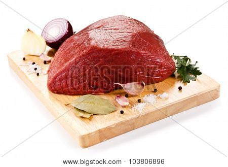 Fresh raw beef on cutting board on white background