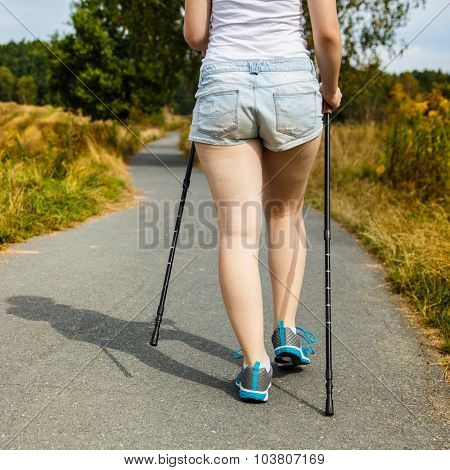 Nordic walking - young woman working out
