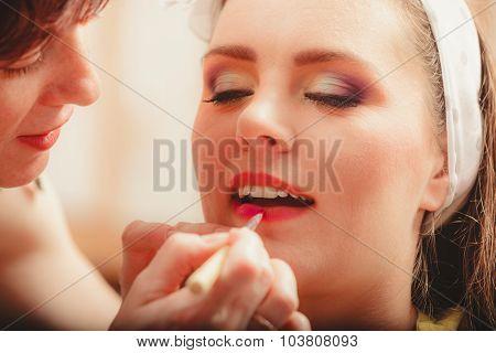Make Up Artist Applying Lipstick With Brush.