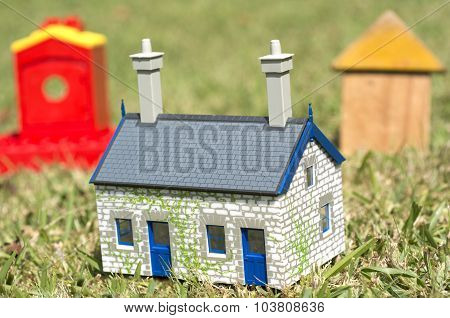 Houses On Green Grass