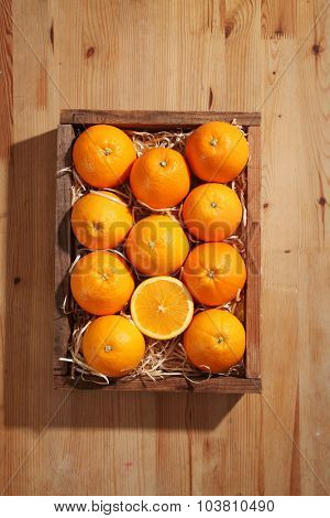 oranges in the wooden crate
