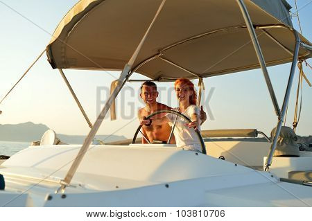 Woman sailing in the yacht on her honeymoon