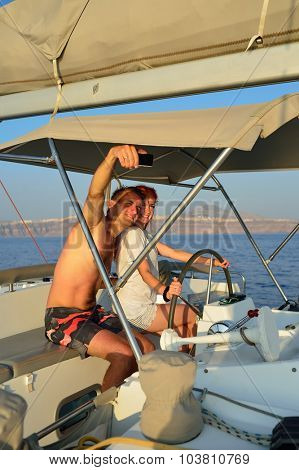 Couple take a selfie photos during sailing in the yacht