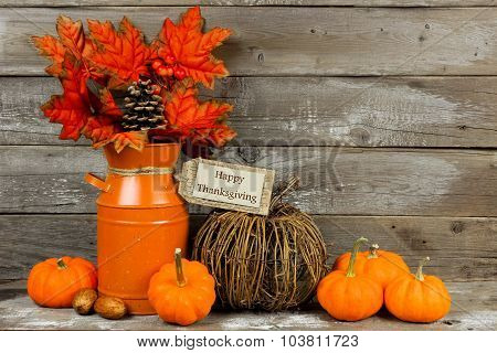 Happy Thanksgiving tag with autumn decor against wood