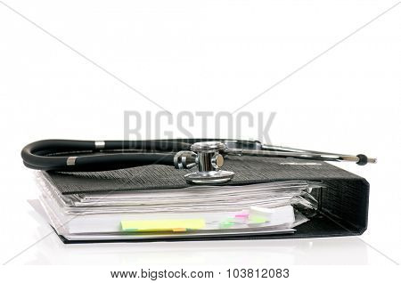 Stethoscope and file folder, isolated on white background
