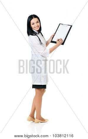 Portrait of smiling female doctor holding a clipboard - isolated over a white background