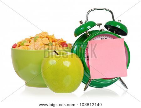 Big green alarm clock with breakfast, isolated on white background