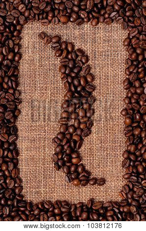 Frame made of coffee beans on the old burlap