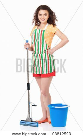 Young housewife with blue bucket and mop, isolated on white background
