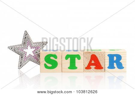 STAR word formed by wood alphabet blocks with magic wand isolated on white background