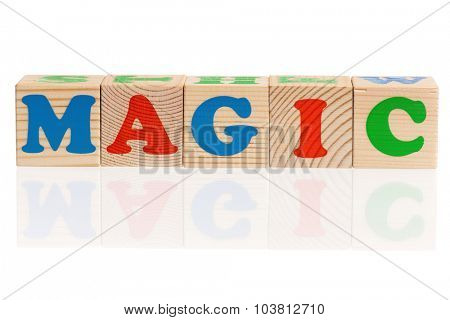 MAGIC word formed by wood alphabet blocks isolated on white background