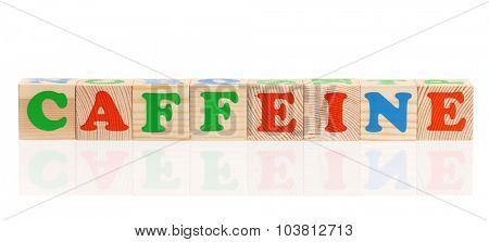 CAFFEINE word formed by wood alphabet blocks, isolated on white background