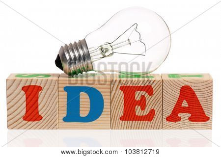 IDEA word formed by wood alphabet blocks with lightbulb, isolated on white background