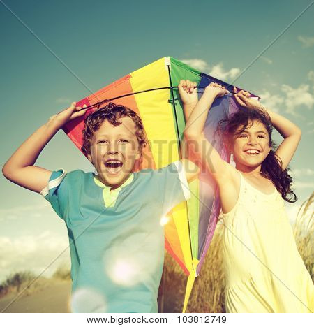 Cheerful Children Playing Kite Outdoors Friendship Concept