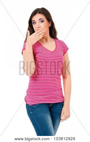 Portrait of a shocked teen girl against isolated white background