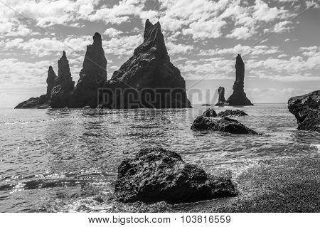 Reynisdrangar rock formations near Vik, Iceland. Monochrome