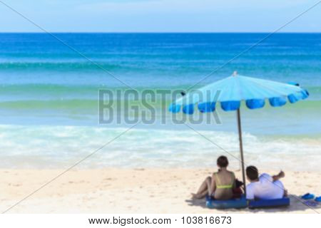 Blurred Image of Tourists At Karon Beach In Phuket Island, Thailand