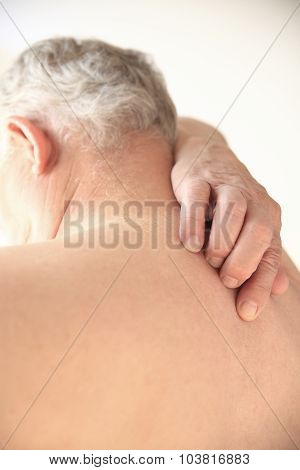 Senior tries to scratch his bare back