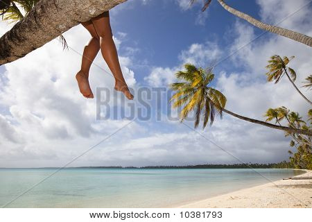 Women's Legs On White Sand Beach