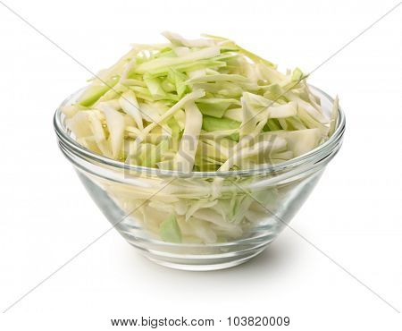 Glass bowl of fresh shredded cabbage isolated on white