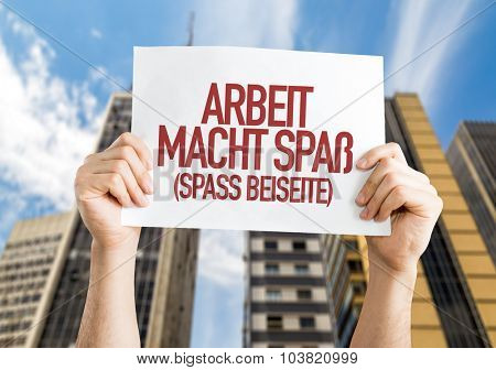 Work is Fun (Joking Aside) in German placard with urban background