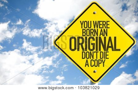 You Were Born An Original Don't Die a Copy sign with sky background